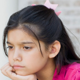 Photo of a 6th-grade girl, looking sad