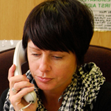 Case manager holding a phone